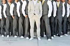 LOVE this - Grey suit for groomsmen with yellow ties, tan for groom!