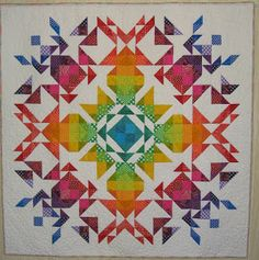 "Stunning ""Modern Roue Chromatique"" (Modern Color Wheel) by Laurie Ceesay of Artsy Chick Quilts, made using the ""Parterre"" pattern."