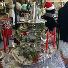 Stacking silver trays on glass vases and cake plates makes a stunning tiered centerpiece! Seen at Jane Asher Antiques in Hendersonville, NC