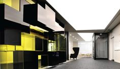 A black stone-chip path leads through the carpeted space - The Interiors Group
