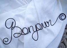 Perfect decor for a French or Paris theme. Or just a travel lover. Very durable hand scripted Bonjoursign. Choose your color from the menu.  CUSTOM PHRASE? Please send me a message for a quote.  DIMENSIONS: Approx 5 inches x 14 inches.  SHIPPING Lead time of 7-14 business days. Made to order and ships Priority with delivery confirmation.   Back to storefront: http://handmadeaffair.etsy.com  NEED MORE or a different color? Click the Contact button to send me a private message.