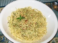 Fiery Angel Hair Pasta with Chili Oil, Red Pepper Flakes, Lemon Zest and Parsley - Top a big bowl of angel hair pasta with this fiery concoction.  http://www.foodnetwork.com/recipes/giada-de-laurentiis/fiery-angel-hair-pasta-recipe.html