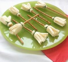Cheese and pretzel witch's brooms tied w/ chives - love this for Halloween!