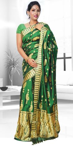 Beautiful Green colour Assam silk pat Mekhla Chadar with artistic Suta work giving a stylish look to the two piece. This gorgeous collection is perfect for any festive occasion.The Mekhla Chadar is a two pc. Saree which comes with matching blouse piece, the blouse shown in the image is just for display purpose.Slight colour variation may be there in display & acutal.