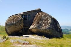 The House of Stone is a two-story home built among four large boulders in an open field in Portugal. The house was built in 1974 as a family's rural retreat. Portugal, Bungalow, Art Nouveau, Unusual Buildings, Rural Retreats, Cabin In The Woods, Wood Architecture, Storey Homes, Unusual Homes