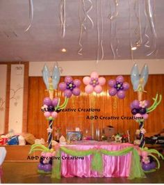 Fairy theme balloon columns and arch