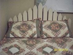 Dale made a headboard for the spare room bed out of picket fence material we had left over.