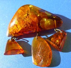 Jewel brooches or label are rings or necklaces which get fastened onto the styles, and might be worn to brighten the wearer or components. Gemstone Brooch, Amber Gemstone, Amber Beads, Gemstone Jewelry, Vintage Jewelry, Handmade Jewelry, Blue Amber, Baltic Amber Jewelry, Round Beads