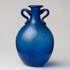 A few examples of Roman glass; The two-handled bottle second shown is early Imperial, dating to the 1st century AD.