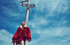 Anne Vyalitsyna models embellished red minidress from Roberto Cavalli with Thomas Wylde fur coat for Vogue Portugal October 2016 issue