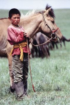 Mongolian boy with his horse