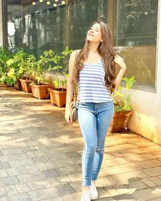 Image may contain: 1 person, standing, stripes and outdoor Indian Fashion Trends, Indian Designer Outfits, Indian Outfits, Teenage Girl Photography, Girl Photography Poses, Stylish Photo Pose, Hiba Nawab, Girl Number For Friendship, Superenge Jeans