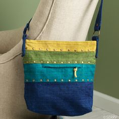 Spring Stripes Hemp Bag This brightly colored shoulder bag with brass embellishments stands out from the crowd, but it's not just another pretty accessory. Sturdy, handwoven hemp and plenty of pockets make it quite utilitarian. Fully lined with top zipper closure. #Fairtrade purse www.serrv.org