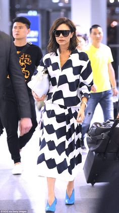 Chic: Victoria Beckham was the centre of attention when she attended a Puyi Wardrobe launch event in Hong Kong on Monday, looking super stylish in a patterned shirtdress