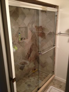 The fully tiled guest bathroom shower enclosure has sliding glass doors. Sliding Glass Door, Glass Doors, Bathroom Shower Enclosures, Siesta Key Beach, Florida Sunshine, Condo Interior, Walk In Shower, Condominium, Laundry Room
