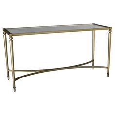 Stage a family of framed photos or bloom-filled vases in the entryway with this stylish console table, featuring a glass top and gold-hued base.