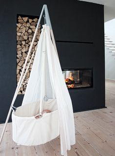 Love this bassinet but would be cool hanging from the ceiling instead on tripod