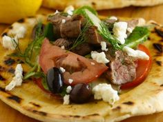 Get this all-star, easy-to-follow Grilled Lamb with Greek Spinach Pita Salad recipe from Bobby Flay