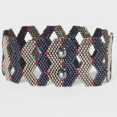 """More shaped peyote stitch exploration, with button clasp"