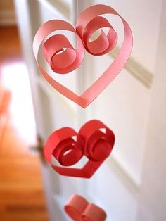 Love these curly paper hearts on a string for a garland across a window.
