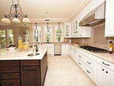 two tone cream and dark brown kitchen cabinet, travertine backspash, tan tile floor, stainless steel appliances - Google Search