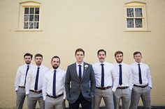 Have groom in suit jacket and groomsmen without. Coordinate with our colors.