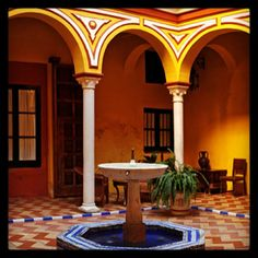 Las Casas de la Judería in Seville is made up of a houses that are connected by beautiful courtyards like this one. Fountains, flower beds and art -- what more can you ask for ?! #justbook #travel #hotels #seville #spain #courtyard #upscale #fountains