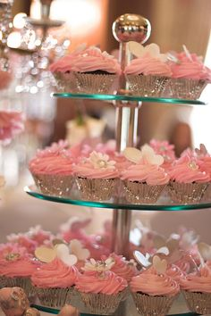 ~ Wicked Chocolate cupcakes in silver cups iced with soft pink butter icing swirl, decorated with pink & white fondant daisies & hearts with silver touches by Charly's Bakery, via Flickr