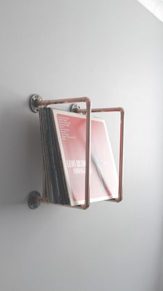 Vinyl collection holder – Handmade from copper pipe – Wall Mounted – apartment.club Vinyl collection holder – Handmade from copper pipe – Wall Mounted