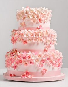 Sweet tiny pink and white flowers with pink ribbons on tiered cake ~ shower cake ~ wedding cake