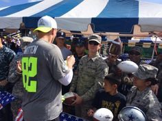 Pro Bowler Jason Witten signs autographs for USAA military VIPs following practice on Hickam AFB