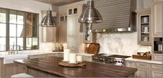 The marble is so beautiful – love the slabs used for the backsplash-Makes for easy and quick wipedown.