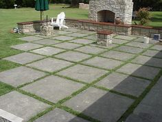 I like this idea of square concrete slabs for patio - might not be feasible with the grading though