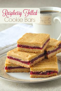 Raspberry Filled Cookie Bars - a sweet and tangy, raspberry fruit filling is sandwiched between two buttery layers of soft, delicious cookie.