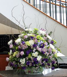 Arrangement from February 25, 2014: spider mums, button mums, lavender roses, lisianthus, hydrangea, willow branches, podocarpus, and alstroemeria.