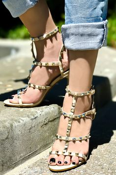 These high heels shoes feature a pu leather open toe , multi strap,pyramid studs accent ,ankle strap buckle, a stiletto high heels shoes measures about 4 inches.