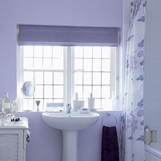 Pick a pretty palette for the bathroom (lavender paint makes the space more inviting)