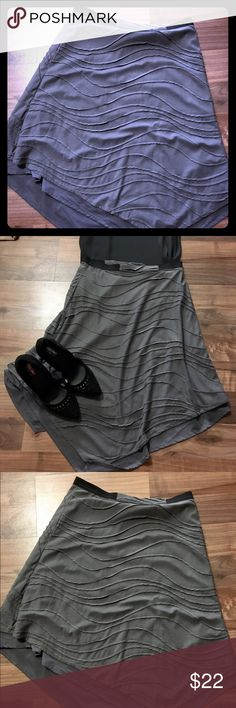 """✔️REDUCED - Vera Wang skirt Grey Vera Wang skirt. Beautiful and flowy with lots of levels. Falls slightly below my knee (I'm 5""""3') and is great for work. Shirt for sale as well, so check out my closet!  15% off bundle with purchase of two or more items! ♥️ Simply Vera Vera Wang Skirts Asymmetrical"""