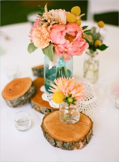 Mason jar centerpiece sitting on wood planks=free + cute. We are thinking of using Maine wildflowers such as chicory, yarrow, and possibly sunflowers for our wedding!