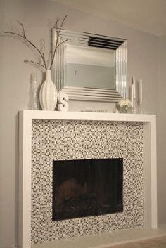 simple fireplace, sleek painted wood surround, glass tile