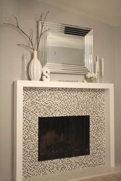 simple fireplace, sleek painted wood surround, glass tile