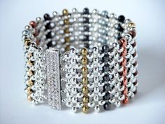 This tutorial provides instruction for making this Metal Bead Sampler Bracelet. It consists of 10 pages of material requirements, instructions and diagrams. It specifically calls for Metal Beads in 14 different colors and a Beadsmith Elegant Elements clasp which must be purchased from your local bead store. If you already know Flat Right Angle Weave, this pattern will be easy for you. If you are new to learning RAW, instructions and diagrams have been included to help you learn this we...