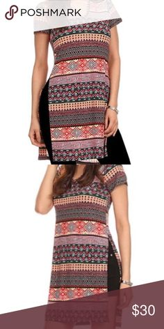Geometric Tunic Channel your inner boho babe with this expressive pink and brown tunic featuring side-slit details and a hood for festival-ready style.  96% polyester / 4% spandex Machine wash Made in the USA Tops Tunics