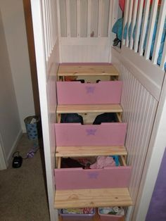 I've seen a few variations on playhouse beds, but having the stairs double as drawers makes this my hands down favorite.