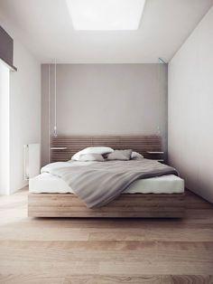 sobere slaapkamer met houten bed