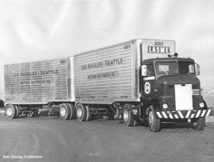 and full trailer. This is part of Ken Goudy's collection. Here is a picture of a Peterbilt belonging to LASME, pulling a set of double trailers.Ken Goudy Collection.