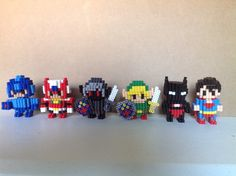 Hey guys! I just finished making these 3D Perler bead designs!  1. Megaman 2. Zero 3. Dark link 4. Link 5. Batman beyond 6. Superman  I did NOT buy megaman and zero at voxels store, i saw them for 15.00+ and thought i could save myself some money by making it my own, i spent hours trying to figure out the patterns just by looking at a picture and i think i finally got them. I will NOT be sharing them to respect voxel and her business. As for dark link, it's just a recolor of basic link…