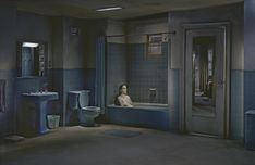 Gregory Crewdson.  Crewdson gives a sense of isolation in this image through  not only the vacant stare and resigned posture of the actor, but also utilising the empty, grungy space in the frame