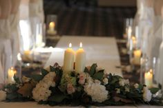 Candlelit Registrars table centres are provided as part of Bartle Hall's high end packages, we make them to compliment the colours and flowers chosen by The Bride & Groom's