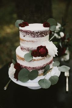 naked wedding cake vanilla red velvet eucalyptus leaves burgundy flowers via aaron whitney photography / http://www.deerpearlflowers.com/greenery-eucalyptus-wedding-decor-ideas/2/